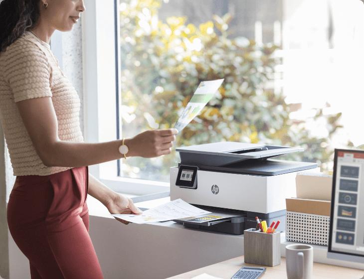 A woman using an HP printer